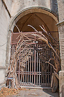 Driftwood art at the entrance to an old church in Arles, France.