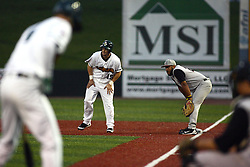 09 June 2011: Colin Moro takes a short lead from firstbase man Jason Taylor  during a game between the Lake Erie Crushers and the Normal Cornbelters at the Corn Crib in Normal Illinois.
