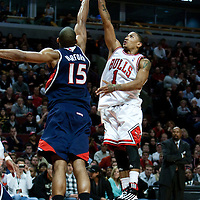 19 December 2009: Chicago Bulls guard Derrick Rose goes for a jumpshot over Atlanta Hawks center Al Horford during the Chicago Bulls 101-98 victory in overtime over the Atlanta Hawks at the United Center, in Chicago, Illinois, USA.