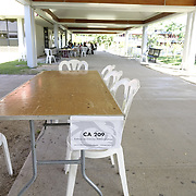 DECEMBER 1, 2017---HUMACAO, PUERTO RICO--<br /> Temporary classroom consisting of a table and plastic chair in a hallway at the University of Puerto Rico's Humacao campus  just outside the normal classrooms. Hurricane Maria damaged a lot of the structures and the school runs on generators since the power has not been restored.<br /> (PHOTO BY ANGEL VALENTIN/FREELANCE)