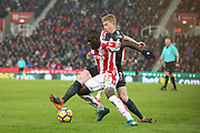 Badou Ndiaye battles with Kevin de Bruyne during the Premier League match between Stoke City and Manchester City at the Bet365 Stadium, Stoke-on-Trent, England on 12 March 2018. Picture by Graham Holt.