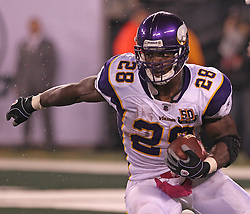 Oct 11, 2010; East Rutherford, NJ, USA; Minnesota Vikings running back Adrian Peterson (28) runs with the ball during the second half of their game against the New York Jets at the New Meadowlands Stadium. The Jets defeated the Vikings 29-20.