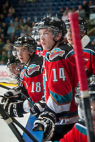 KELOWNA, CANADA - OCTOBER 7: Rourke Chartier #14 of Kelowna Rockets stands on the bench against the Swift Current Broncos on October 7, 2014 at Prospera Place in Kelowna, British Columbia, Canada.  (Photo by Marissa Baecker/Getty Images)  *** Local Caption *** Rourke Chartier;