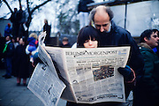 November 12, 1989. Berlin, Federal Republic of Germany. West Berliners follow the latest news from the fall of the Berlin Wall. (Photo Heimo Aga)