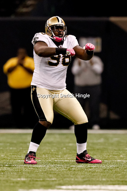 October 3, 2010; New Orleans, LA, USA; New Orleans Saints defensive tackle Sedrick Ellis (98) celebrates following a sack against the Carolina Panthers during the first quarter at the Louisiana Superdome. Mandatory Credit: Derick E. Hingle