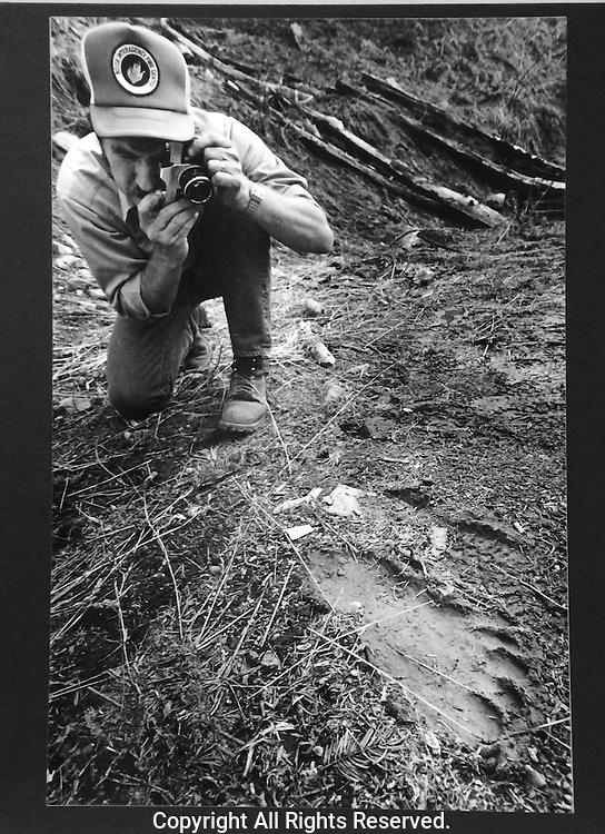 Forest Service employee taking a photo of an alleged Bigfoot foot print in the mud near the Mill Creek Watershed in Oregon SE of Walla Walla Washington in June 1982. (John Froschauer Photo)