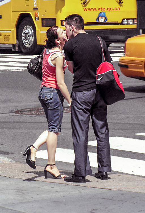 Couple kissing on 5th Av. NYC 2005