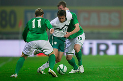 Armin Bacinovic of Slovenia between Grant McCann of Northern Ireland and Chris Brunt of Northern Ireland during EURO 2012 Qualifications game between National teams of Slovenia and Northern Ireland, on March 29, 2011, in Windsor Park Stadium, Belfast, Northern Ireland, United Kingdom. (Photo by Vid Ponikvar / Sportida)