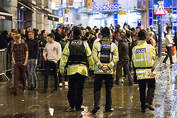 """© Licensed to London News Pictures . 15/12/2012 . Manchester , UK . Police on patrol on busy streets . Revellers enjoy a wet but busy night out on one of the last weekends before Christmas , a traditionally busy time when office parties and clubbers decent on bars and clubs , often known as """" Mad Friday """" . Photo credit : Joel Goodman/LNP"""