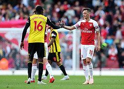 Arsenal's Mesut Ozil shakes hands with Watford's Abdoulaye Doucoure at full time