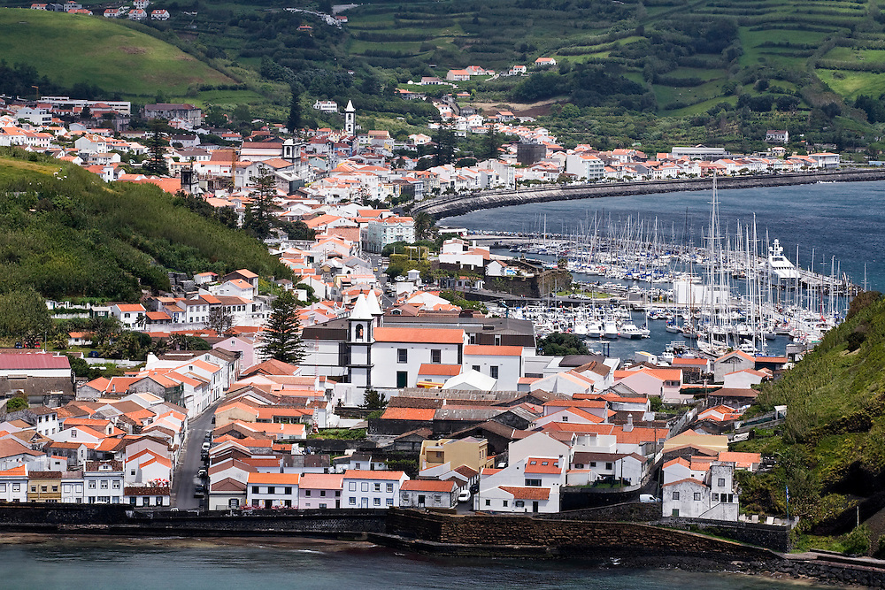 A view across Port Pim and Horta from Monte da Guia. The view includes Horta harbor and the yachts there. Horta is on the island of Faial. One of of the Azores, which is  a group of islands in the Atlantic that are a part of Portugal and the European Union. Horta is a popular stop for yachts crossing the Atlantic in the Spring time to return to Europe.