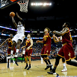 Nov 22, 2013; New Orleans, LA, USA; New Orleans Pelicans point guard Jrue Holiday (11) goes to the basket against the Cleveland Cavaliers during the second quarter of a game at New Orleans Arena. Mandatory Credit: Derick E. Hingle-USA TODAY Sports