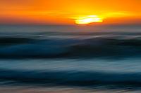 Sunrise over a tranquil sea, Struisbaai, Western Cape, South Africa
