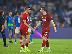 NAPLES, ITALY - Tuesday, September 17, 2019: Liverpool's James Milner (L) and Andy Robertson shake hands after the UEFA Champions League Group E match between SSC Napoli and Liverpool FC at the Studio San Paolo. Napoli won 2-0. (Pic by David Rawcliffe/Propaganda)