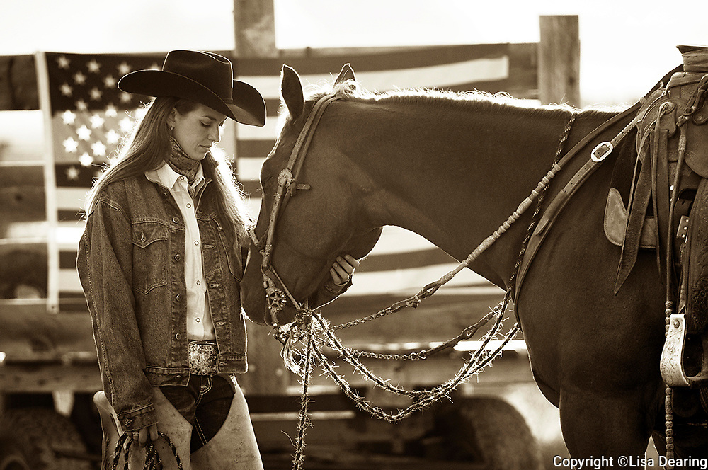 Cowgirl with American Flag and Horse