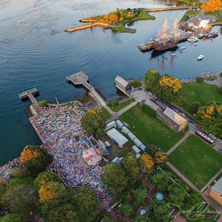 An aerial view of the Bela Fleck concert at Prescott Park Arts Festival in Portsmouth, NH. July 2015. The tall ship El Galeón Andalucía is docked at the commercial fishing pier at the upper right of the pic.
