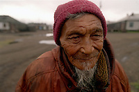 039078.AA.0820.warming20.kc--Russia--Bering Sea, Off Providenya, Russia--An old man in the town center. The story deals with the enviromental issue of global warming throughout the region of Russia directly across the Bering Sea from Nome, Alaska. The story touches on the people their way of living, the rough economy and the extent they are effected by the slowly warming temperature as documented by scientists.  More Details To Come.