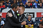 the managers greet each other during the Sky Bet Championship match between Bolton Wanderers and Derby County at the Macron Stadium, Bolton, England on 8 August 2015. Photo by Mark Pollitt.