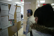 Job seekers look at job offers at an INEM state employment office on February 10, 2009 in Bilbao, Spain. Photographer: Markel Redondo/Fedephoto.