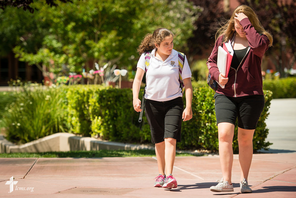 Mentor Merissa Lehr (far right) walks with Mark 10:14 Program student Bailey Lamonte following class at Faith Lutheran Middle School & High School on Tuesday, May 26, 2015, in Las Vegas, Nev.  LCMS Communications/Erik M. Lunsford