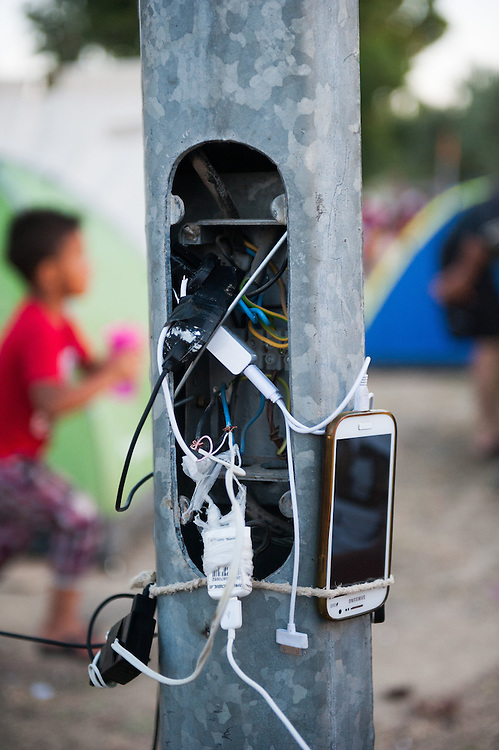 Since there are no electricity plugs in Kara Tepe camp, refugees and immigrants have hacked the street lights poles to charge their mobile phones.