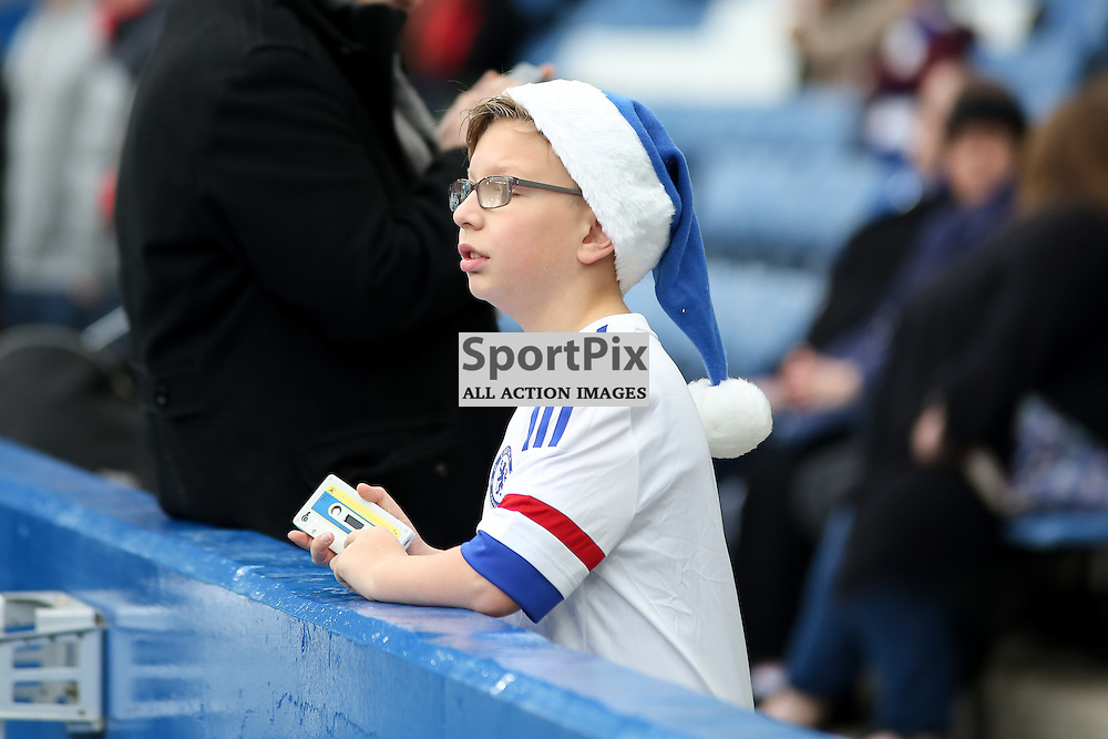 A child in a chelsea Christmas hat During Chelsea vs Sunderland on Saturday the 19th December 2015.