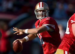 Dec 27, 2009; San Francisco, CA, USA;  San Francisco 49ers quarterback Alex Smith (11) throws against the Detroit Lions during the second quarter at Candlestick Park. San Francisco defeated Detroit 20-6.