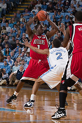 28 December 2006: Rutgers guard (1) Marquis Webb defended by guard (2) Wayne Ellington during a 87-48 Rutgers Scarlet Knights loss to the North Carolina Tarheels, in the Dean Smith Center in Chapel Hill, NC.<br />
