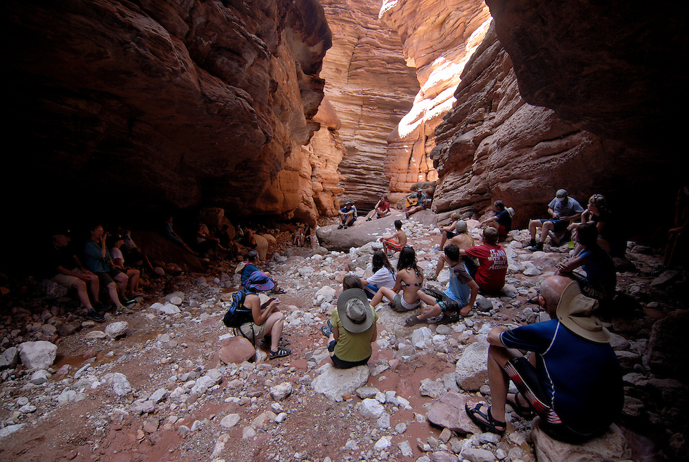 Tourists watching a girl playing the guitar,Grand Canyon River trip