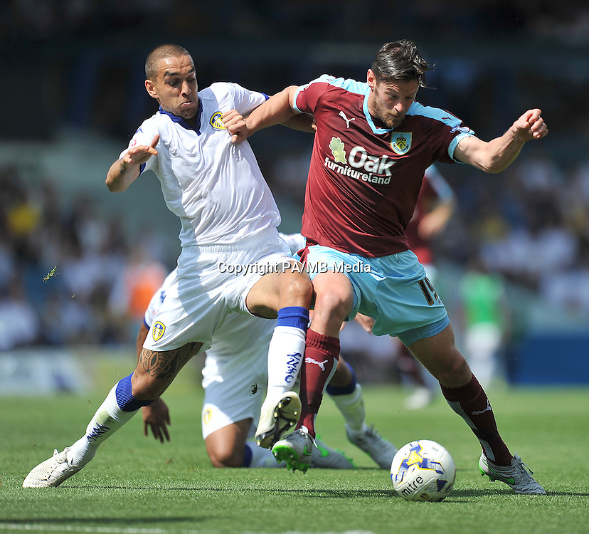 "Burnley's Lukas Jutkiewicz (right) battles with Leeds United's Giuseppe Bellusci during the Sky Bet Championship match at Elland Road, Leeds. Picture date: Saturday August 8, 2015. See PA story SOCCER Leeds. Photo credit should read: Dave Howarth/PA Wire. EDITORIAL USE ONLY No use with unauthorised audio, video, data, fixture lists, club/league logos or ""live"" services. Online in-match use limited to 45 images, no video emulation. No use in betting, games or single club/league/player publications."