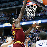 22 March 2017: Cleveland Cavaliers center Tristan Thompson (13) goes for the layup against Denver Nuggets guard Jameer Nelson (1) and Denver Nuggets forward Nikola Jokic (15) during the Denver Nuggets 126-113 victory over the Cleveland Cavaliers, at the Pepsi Center, Denver, Colorado, USA.
