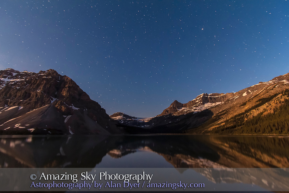 A moonlit nightscape taken at Bow Lake, Banff, Alberta on July 6/7, 2012. Illumination is from the waning gibbous Moon off camera to the left and from the vestiges of evening twilight. This is looking west toward Bow Glacier. This is a single frame from a series of 314 frames taken over 3.5 hours for a time-lapse sequence. This is 45 seconds at f/4.5 and ISO 1600 with the Canon 60Da and 10-22mm lens at 10mm. Arcturus is high in the sky at right.