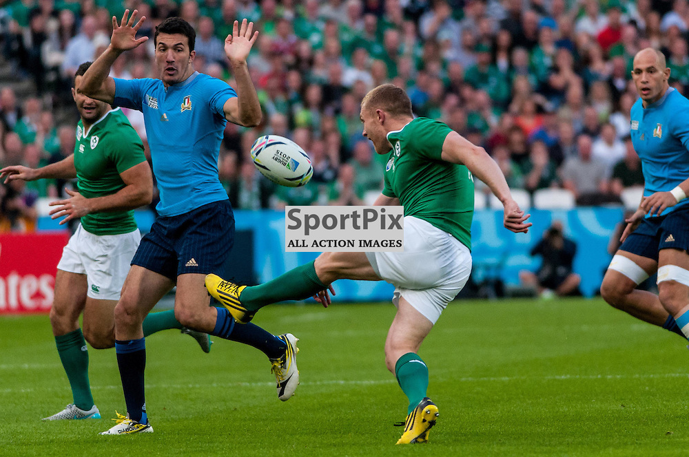 Try scorer Keith Earls of Ireland kicks ahead. Action from the Ireland v Italy pool game at the 2015 Rugby World Cup at Queen Elizabeth Stadium in London, 4 October 2015. (c) Paul J Roberts / Sportpix.org.uk