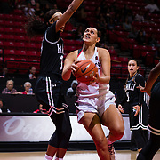 09 November 2018: San Diego State Aztecs forward Baylee Vanderdoes (34) drives the ball to the basket while being defended by Hawaii Warriors forward Makenna Woodfolk (35) in the third quarter. The Aztecs opened up it's regular season schedule with a 58-57 win over Hawaii Friday at Viejas Arena.