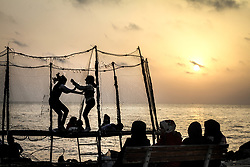 April 30, 2017 - Gaza, Gaza Strip, Occupied Palestinian Territory - Palestinian children are playing on a swing in the yard of Gaza port, during the sunset. (Credit Image: © Ahmad Salem via ZUMA Wire)