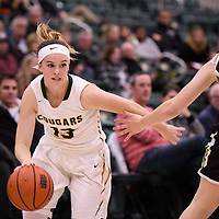 1st year guard Faith Reid (13) of the Regina Cougars in action during the home opener on November  10 at Centre for Kinesiology, Health and Sport. Credit: Arthur Ward/Arthur Images