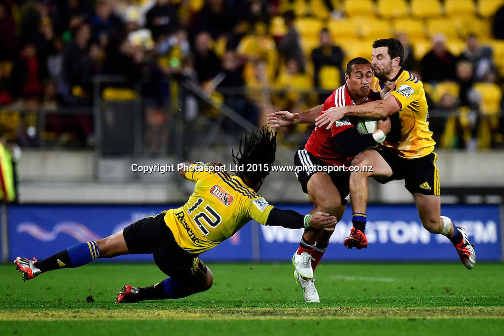 Crusaders' Nafi Tuitavake (C is tackled by Hurricanes' James Marshall (R and Hurricanes' Ma'a Nonu during the Super Rugby Hurricanes v Crusaders rugby match at the Westpac Stadium in Wellington on Saturday the 2nd of May 2015. Photo by Marty Melville / www.Photosport.co.nz