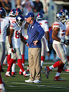 New York Giants head coach Tom Coughlin watches pre game warmups before the 2014 NFL Pro Football Hall of Fame preseason football game against the Buffalo Bills on Sunday, Aug. 3, 2014 in Canton, Ohio. The Giants won the game 17-13. ©Paul Anthony Spinelli