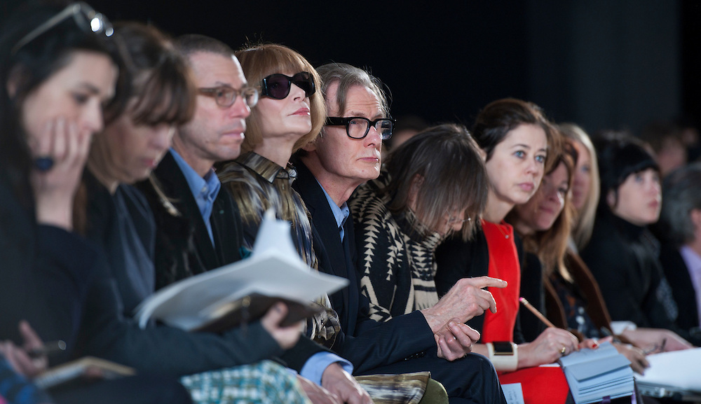 Vogue editor Anna Wintour sits next Bill Nighy during the Mulberry catwalk show at London Fashion Week on 19/02/12.photo Ki Price
