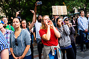 Counter-protesters gesture and shout at the speakers at the Freedom Rally at Westlake Park. Seattle, WA. August 13, 2017.