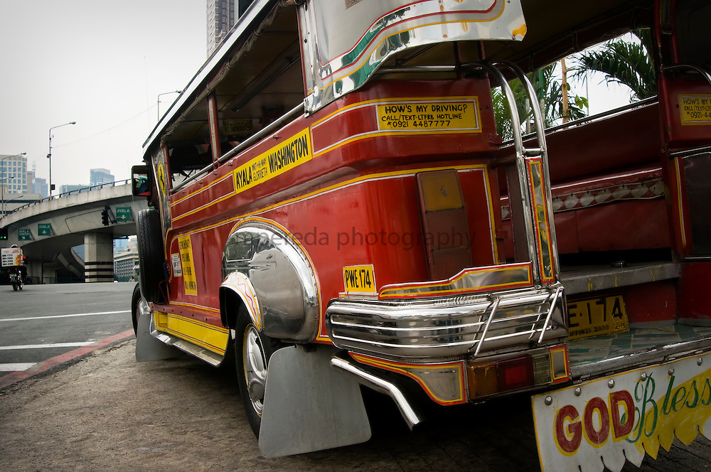 MANILA (Philippines). 2009. Jeepney in Makati. Jeepneys were originally made from US military jeeps left over from the WWII. Nowadays are the most popular means of public transportation in the Philippines and also become a symbol of Philippine culture.