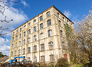 Nineteenth century five storey high historic Ashton Mills industrial mill building, Trowbridge, Wiltshire, England, UK