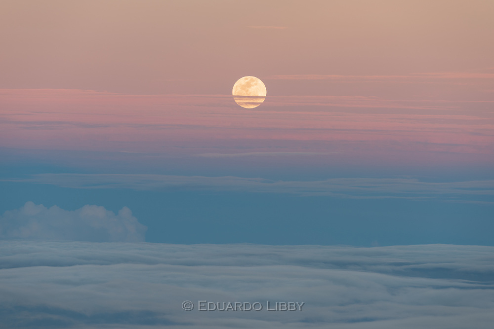 Moonrise over Costa Rica's Caribbean coast as seen from Irazu Volcano. The Moon is just above Earth's shadow.