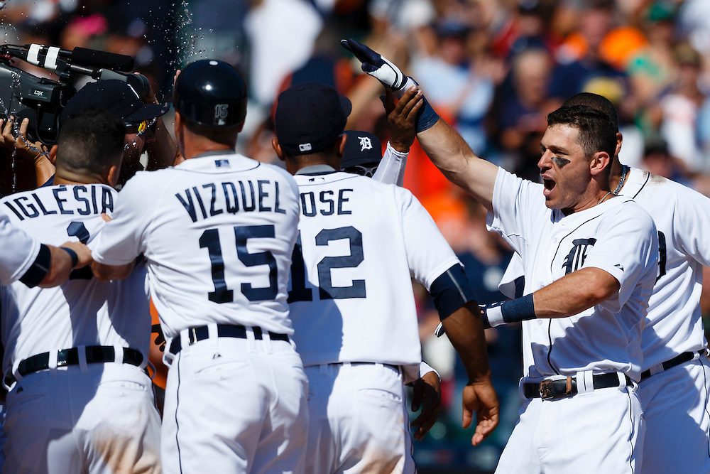 Aug 6, 2015; Detroit, MI, USA; Detroit Tigers second baseman Ian Kinsler (right) receives congratulations from teammates after he hits a walk off two run home run in the ninth inning against the Kansas City Royals at Comerica Park. Detroit won 8-6. Mandatory Credit: Rick Osentoski-USA TODAY Sports