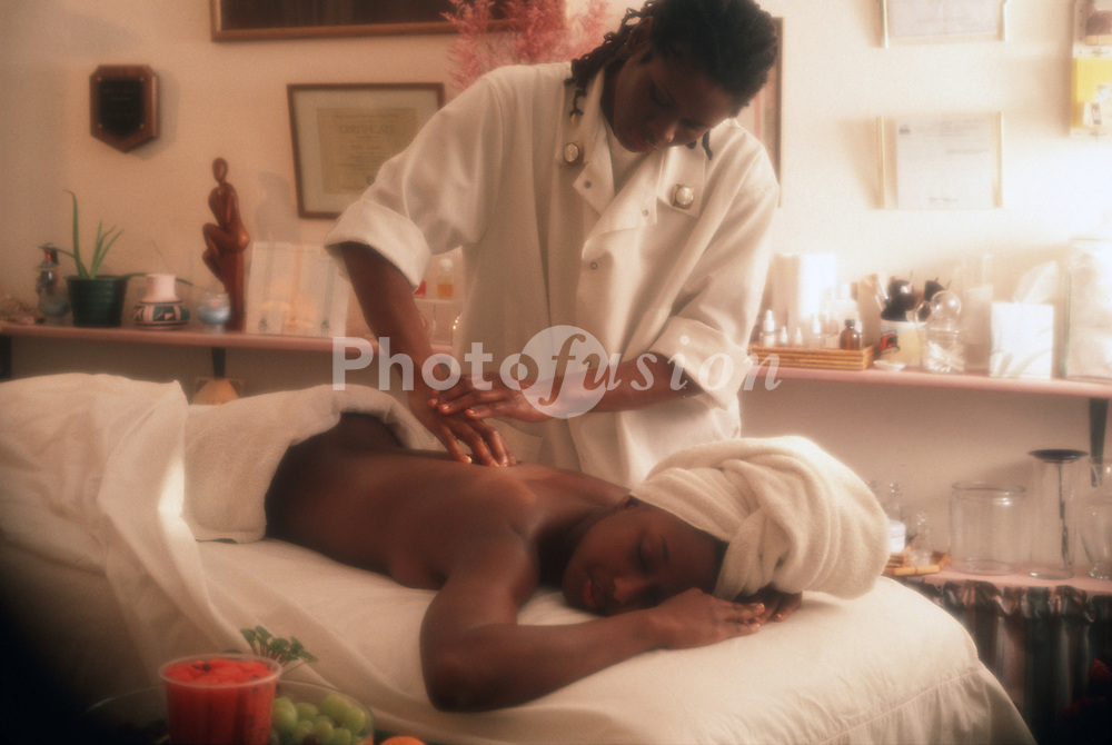 Woman having back massage at a health spa UK