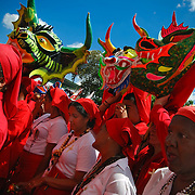 DANCING DEVILS OF YARE / LOS DIABLOS DE YARE<br /> Photography by Aaron Sosa<br /> Yare, Miranda State - Venezuela 2009.<br /> (Copyright © Aaron Sosa)<br /> <br /> The Dancing Devils of Yare is a religious festival held in the town of San Francisco de Yare in Miranda State, Venezuela.<br /> <br /> Every Corpus Christi, or 60 days after Easter, men from Yare dress in red robes, capes and masks of grotesque demons and dance in the streets to the rhythm of drumbeats and maracas. They adorn...<br /> more »<br /> DANCING DEVILS OF YARE / LOS DIABLOS DE YARE<br /> Photography by Aaron Sosa<br /> Yare, Mirana State - Venezuela 2009.<br /> (Copyright © Aaron Sosa)<br /> <br /> The Dancing Devils of Yare is a religious festival held in the town of San Francisco de Yare in Miranda State, Venezuela.<br /> <br /> Every Corpus Christi, or 60 days after Easter, men from Yare dress in red robes, capes and masks of grotesque demons and dance in the streets to the rhythm of drumbeats and maracas. They adorn their costumes with scapulars, rosaries, crosses and other religious objects.<br /> <br /> After dancing the devils congregate at the historical San Francisco Catholic church and kneel in silence before being blessed by a priest. The kneeling symbolizes respect and their religious promise to end their evil ways. After being blessed, dancing and music continue as the devils go in a large procession to visit the homes of the deceased throughout their town. The celebration lasts until the end of the afternoon, when church bells are sounded and brotherhood spreads, signifying the triumph of good over evil for one more year.<br /> <br /> The festival's origins date back to the eighteenth century, and being allowed to participate is considered a tremendous honor. The fraternity of men associated with the festival is celebrated as the oldest brotherhood still practicing its traditions, on the entire American continent. Their masks differentiate their place in the fraternity's hierarchy, and it is not uncommon to find men who have danced annually as devils for more than twenty or thirty years.