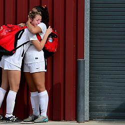 Yorba Linda's Rebecca Ornelas, right, consoles teammate Kaci Stewart as South Hills defeated Yorba Linda 2-1 during a prep Division 3 girls soccer championship match at Corona High School in Corona, Calif., on Saturday, March 5, 2016.