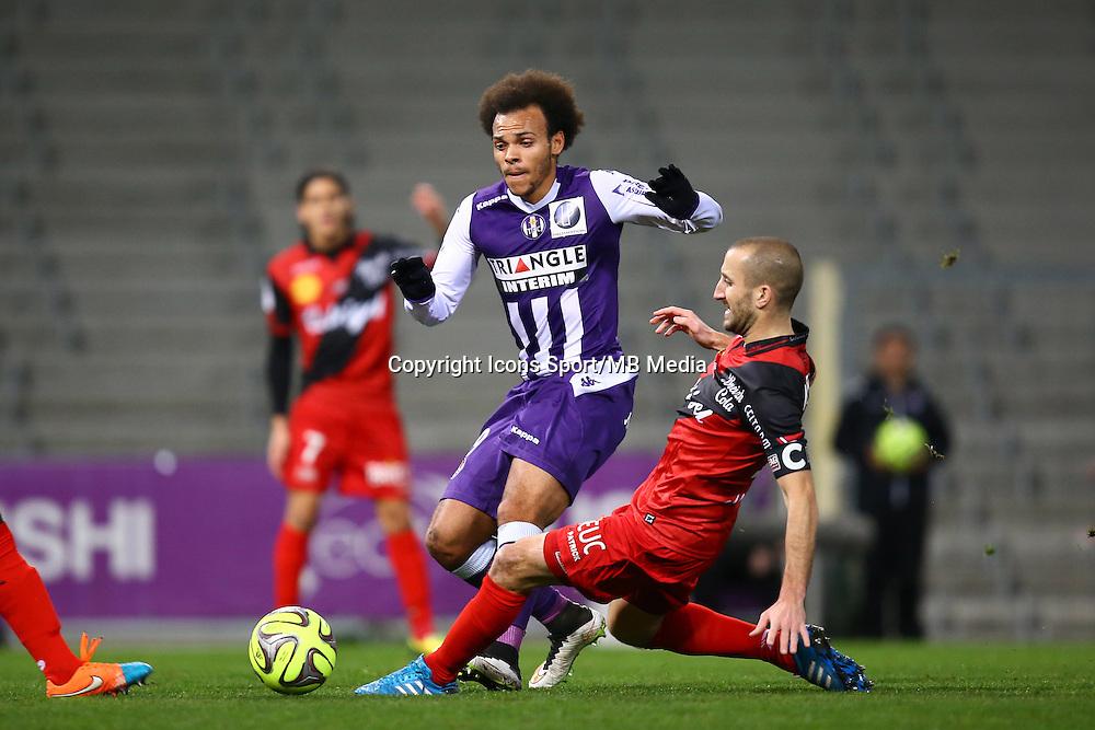 Martin Braithwaite / Lionel Mathis - 20.12.2014 - Toulouse / Guingamp - 19eme journee de Ligue 1 <br />Photo : Manuel Blondeau / Icon Sport