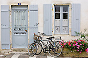 Traditional home with bicycles, Ile De Re, France.