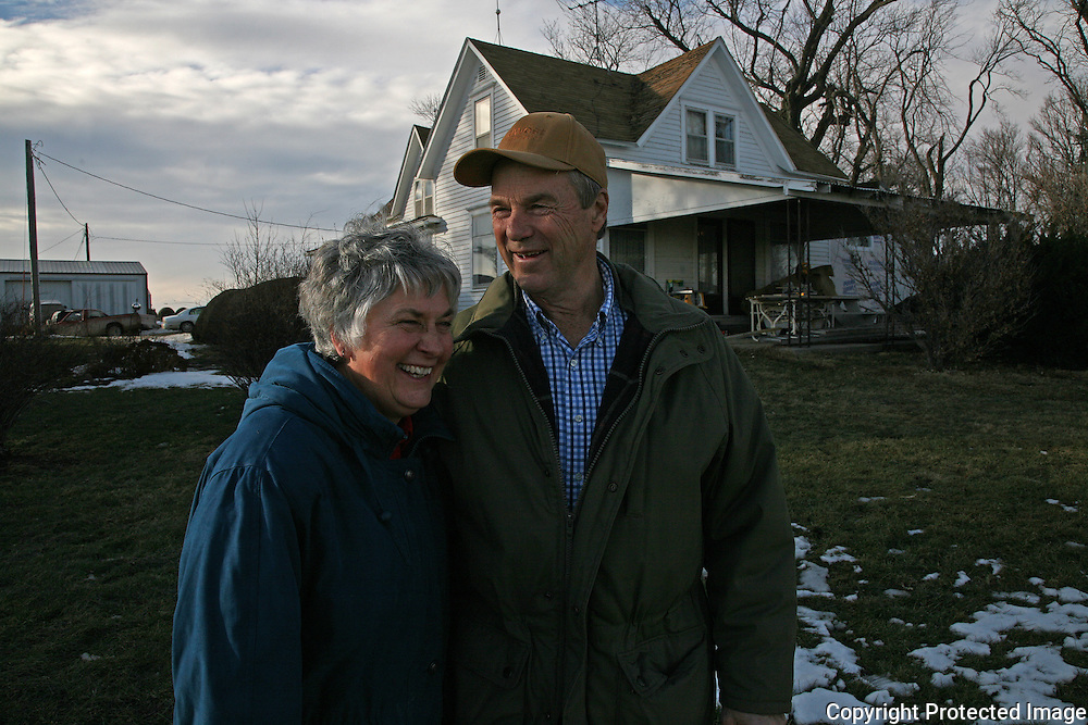 """On a seasonably warm day in January, Karen and Bill Johnson enjoy the sunshine and beautiful sky on their family farm in Shelby County, Iowa.  The Johnson's have been farming together since their marriage in 1968.  <br /> <br /> """"We lived through the 80's by the skin of our teeth,"""" says Karen, referring to the lean economic years of the farm crisis.  <br /> <br /> The Johnson's, who plant 1330 acres of corn, soybeans and alfalfa, along with tending to a small herd of cattle, don't plan to retire anytime soon.  <br /> <br /> """"Neither of us has a notion of moving into town and having neighbors 5 feet from our front door,"""" says Karen.    Photo by David Peterson"""